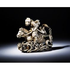 Netsuke, ca. 1850-1900 (made), Rakueisai (maker), Carved and stained ivory, in the form of the Chinese general Gentoku, riding across a river on a horse. The source of this netsuke is a double-page spread from the Ehon shaho bukuro (Bag of sketching treasures). There are, however, slight differences between the netsuke and the original.