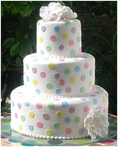 Multi coloured dots - would lose the flowers & just have a co-ordinating ribbon around base each cake. Maybe Easter?