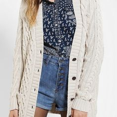 Urban outfitters BDG fisherman cardigan Worn a few times. Excellent condition. Chunky cable knit cream cardigan. With brown buttons and pockets. Brand is BDG from urban outfitters. I really hate to let this one go as it is one of my favorite pieces, but it just doesn't fit the best on my short body and hope someone will love it just as much as I do❤️ Urban Outfitters Sweaters Cardigans