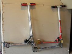 Do your scooters look like this on your garage floor? See the blue tape? They're not suppose to cross that line but they often do. And I often trip over them. I found a simple solution for only $1 at the Dollar Tree. All 4 hooks came in one package. I strategically placed the hooks …