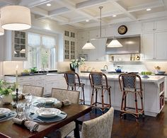 Love this kitchen with its informal dining table and island seating,