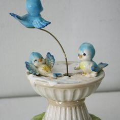 "Vintage Norcrest musical bluebirds. One ""flies"" around the bird bath, to the tune ""Born Free."""