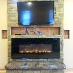 Hand color dying of the brick pattern and replacement of TV and electric fireplace insert nearly complete the project.