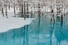 Blue Pond & Spring Snow, Hokkaido, Japan ~ by Kent Shiraishi