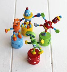 Set Of Wooden Push Up Robots from notonthehighstreet.com
