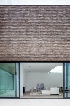 Kleur baksteen hoge ramen