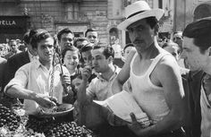 A man sells fresh cherries in Naples Italy 1952.