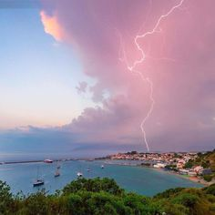 """A storm cell spewing a lightning bolt above Pythagoreio, #Greece.  The World Meteorological Organization (WMO) has launched their photo competition for the WMO 2018 calendar. The title is """"Weather-ready, climate-smart"""" to reflect the theme of World Meteorological Day on 23 March 2018.  Weather is becoming more extreme because of climate change. We need to increase resilience through better early warning systems and more coordinated responses. WMO is therefore looking for photographs which…"""