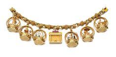A gold and diamond charm link bracelet, 1945.