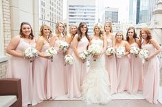 Bridesmaids in blush floor-length gowns and white bouquets. Photo by Perez Photography, Lighting by Beyond, Wedding by Hannah Kohler of DFW Events. #wedding #white #bridesmaids #blush