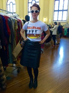 Libby wears 80s panelled black leather pencil skirt by The Crown St Project.