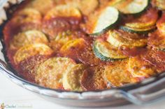 An easy squash tian recipe that is layered with zucchini, yellow squash, spaghetti sauce, parmesan cheese, and optional pepperoni!