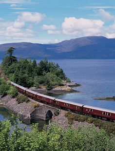 The heather is in bloom in the Scottish Highlands.  take the Classic Whisky Journey aboard the Royal Scotsman.