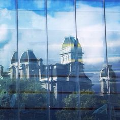 Hall of Languages reflected off of Newhouse 3 #SyracuseU