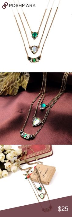 Beautiful Layered Stone Crystal Necklace Brand new. Excellent quality! This necklace is absolutely stunning. Elegant and artistic. 3 layers all different lengths. Lobster clamp. Chain length is about 42cm + 7cm. Bronze chain with shining green and white rhinestones. Jewelry Necklaces