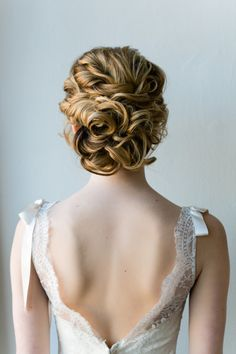 Pretty updo with plenty of twists and curls at the nape