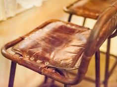 I want these bar stools with distressed leather seats and backs! Image © Paul Winch-Furness Photography