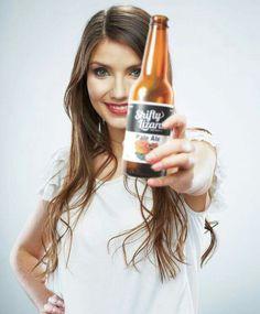 Pale ale bottle from Shifty Lizard brewing held by woman