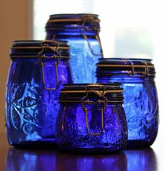 Cobalt blue glass jars with snap-flip lids.