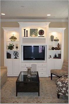 built in -like the media storage under the tv, have drawers for the dvd's and then the area for the DVD player and tv box hidden in between. Like how the tv is flush