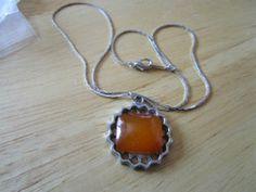 "Just updated silvertone 16""long chain + silvertone pendant 1""across amber square stone centre £1.25"