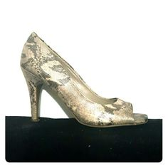 Snake Skin Shimmer Peep Toe Pump Snake Skin Shimmer Peep Toe Pump. Worn only a couple of times. 3.5 inch heel. Shoes Heels