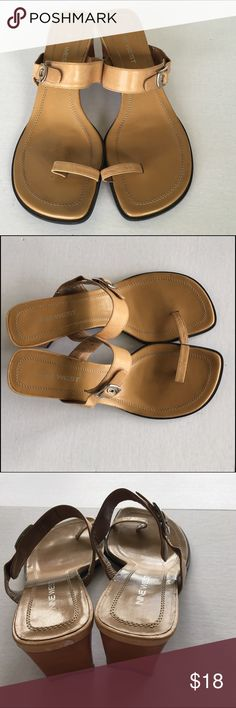 """Vintage Nine West Tan Leather Mule Sandals - 7 These mule style sandals have a 2.5"""" heel. The tan leather straps have an adjustable silver buckle and elastic for perfect fitting! The toe ring is approx. 1.5"""" wide by 1"""" high. U.S. Women's size 7 . These are in very great condition for their age!! --- Vintage Nine West's quality and style! Nine West Shoes Sandals"""