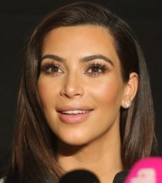 Kim looking beautiful with toned down makeup.