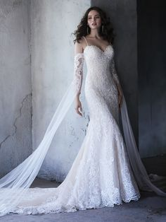 Maggie Sottero - CASSANDRA, Be true to the classics, but embrace the details. This romantic fit-and-flare wedding dress features a timeless silhouette, while delicate spaghetti straps and delicate lace train add the perfect dose of ooh-la-la.
