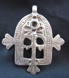 """Africa, Old Silver Talisman - GATES of PARADISE - Morocco   eBay  Old Berber Talisman - GATES of PARADISE - Morocco  19th century. Sterling Silver. Gr. 25,2 (0.89 oz.); cm. 7,4 x 6,7 (2.91'' x 2.64"""").    This talisman reveals the perfect mastery of the Jewish Berber artisans. Beautiful and rare item.    Visit our store on ebay.it:  http://stores.ebay.it/amazighmagicaljewelry"""