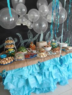 Real Mermaid Party Balloon party table backdrop. Used different sized balloons from ebay seller to create a Bubble Wall.