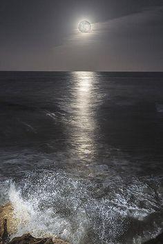 Full Moon Over a Dark Ocean.