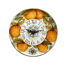 Wall clock decorated by hand with flowers and oranges.