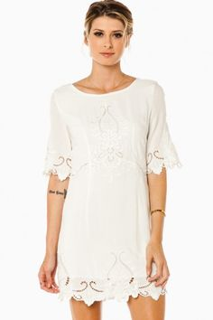This dress features tonal embroidery and various cutouts. Elbow sleeves, back zipper.