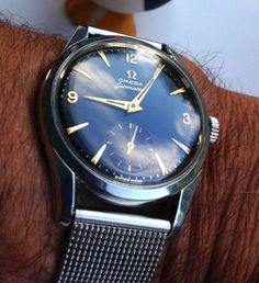 omegaforums:  Gorgeous Vintage Omega Seamaster With Sub-Seconds On Mesh Bracelet Circa 1950s  -lose the bracelet-