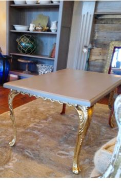 Amy Howard One Step painted top and gilded legs make an interesting contrast. #amyhoward #gilding http://thetreasuredhome.com/furniture-painting-2/amy-howard-at-home/featured