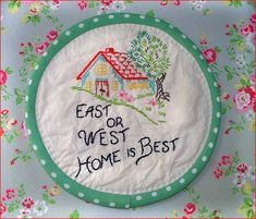 .This looks as if someone began with a vintage dishtowel...of course, it might also be new.  It appears to be a hot pad or dish trivet.