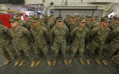 U.S. Marines stand aboard the USS Bonhomme Richard amphibious assault ship during a ceremony marking...
