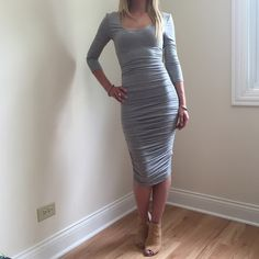 Gray Midi Dress Soft midi dress with rouching on both sides. Size Small Length 42in Bust 14in Waist stretches to about 16-17in Sleeve 17in. Size Medium Length 43in. Bust 15in. Waist stretches to around 18-19in. Sleeve 17in. Dresses Midi