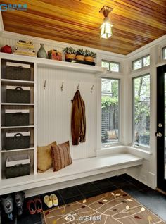 Would love to build on a mud room like this with my washer and dryer in it.
