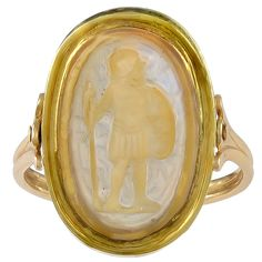 An Ancient Oval Agate Cameo Gold Ring Depicting a Greek Warrior. Standing, looking to his left and holding a spear and a shield. The reverse of the stone is engraved with later Persian script which does not show in the photograph. It can be assumed that this cameo was probably war booty from the Athenian Persian wars of 480 BC and thereafter.The Cameo is set in a simple English Georgian revolving ring mount, circa 1760 and tests for 18k Gold.
