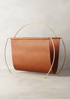 [Saddle Ring Magazine Rack by Anthropologie]