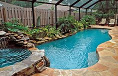I love this! Hot tub, waterfall, tanning seat, steps, rocks/natural landscape with screen enclosure. Pretty much perfection!  Free-Form Pools | Blue Haven Pools
