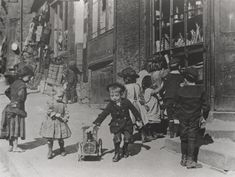 Children playing on a street, ca. 1890.   vintage everyday: Children Playing – Vintage Photos of Children's Fun That Could Have Lost Today