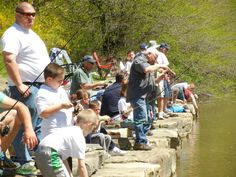 Anglers and their accompanying adults cast their lines at McDade Park in the annual fishing derby.
