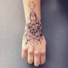 Afbeeldingsresultaat voor hand wrist mandala tattoos