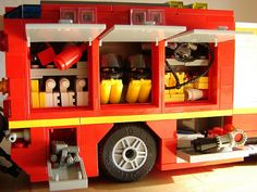 Contents of the right side compartements: SCBAs, hydraulic rescue tools, fire hoses and a mobiile water cannon, amongst other stuff. Lego City Fire Truck, Lego Truck, Fire Trucks, Lego City Sets, Lego Sets, Lego Ambulance, Doll House For Boys, Lego Village, Lego Fire