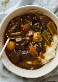 Overhead photo of Beef Stew over mashed potato in a rustic cream bowl. Steak Recipes, Crockpot Recipes, Soup Recipes, Cooking Recipes, Oven Cooking, Easy Cooking, Recipes Dinner, Vegan Recipes, One Pot Meals