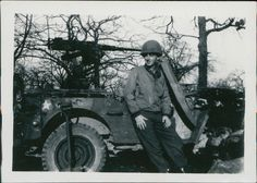 L.T. J.L. Huffines with his Jeep in Belgium, February 1945. Huffines has been depending on Jeep reliability since 1941.