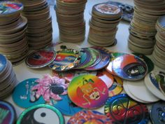 POGS! I still have all of ours, including our Jurassic Park slammer :) My bros and I were OBSESSED.